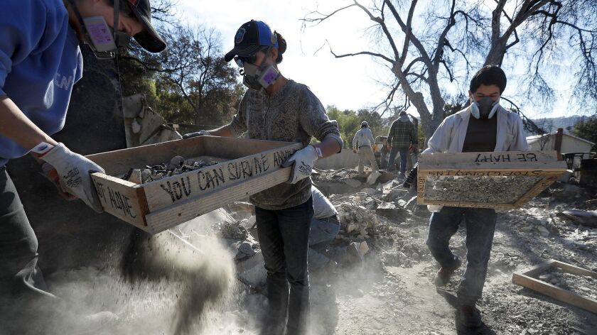 OJAI, CA-DECEMBER 28, 2017: Amanda Rogers, left, and her daughter Naomi help sift through the rubble