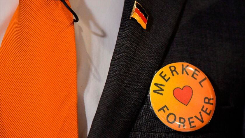 A delegate at the congress of Germany's Christian Democratic Union party wears a pro-Merkel badge on Feb. 26, 2018, in Berlin.