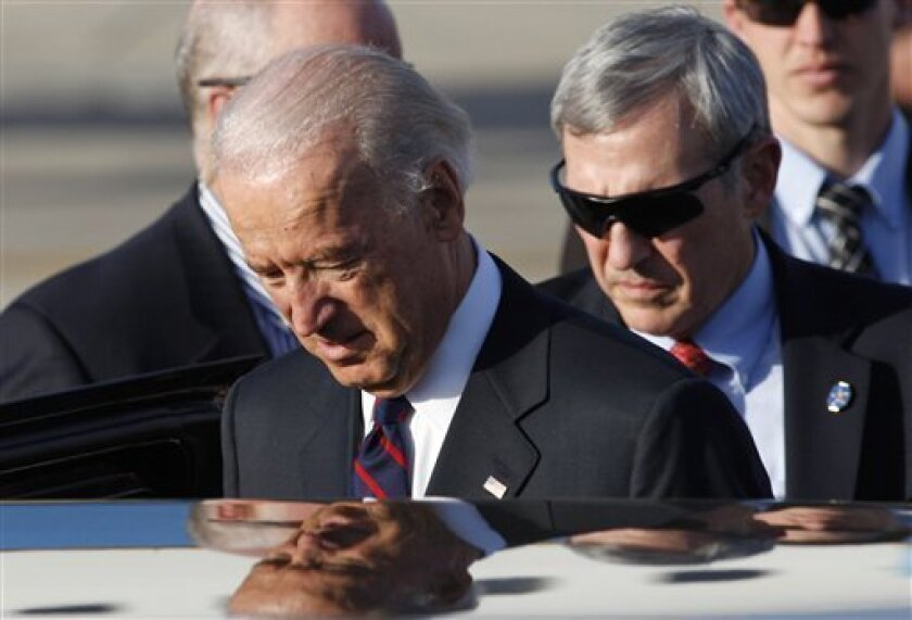 Vice President Joseph Biden, center, enters a car upon his arrival to Ben Gurion airport, near Tel Aviv, Israel, Monday, March 8, 2010. Biden arrived to Israel Monday, the first leg of a five-day tour of the Middle East. Biden's trip is the highest-level visit to Israel and the Palestinian territories yet by an Obama administration official. (AP Photo/Baz Ratner, Pool)