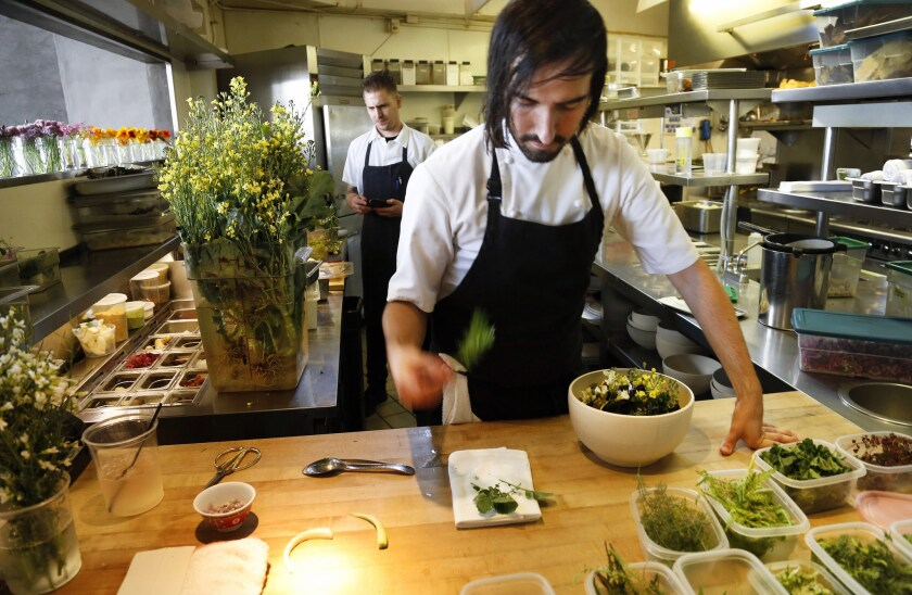 Chef Jordan Kahn prepares a dish inside the kitchen at Red Medicine restaurant in Beverly Hills earlier this year.