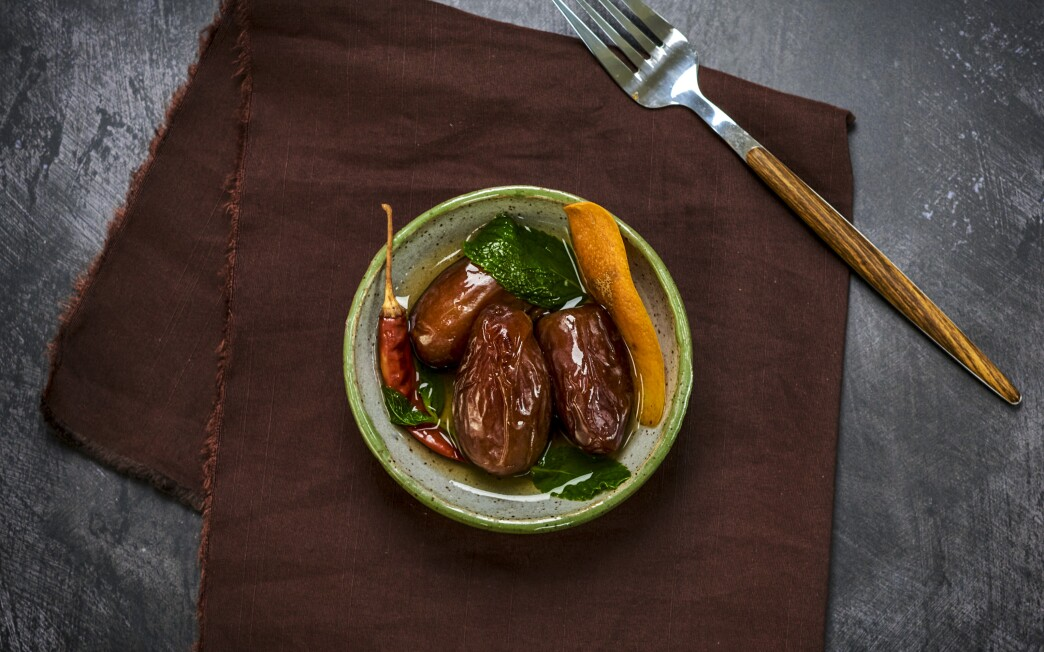 Dried chiles, orange zest and fresh mint add zing to sweet dates in this aromatic snack.