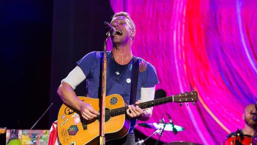 Chris Martin of Coldplay performs at The Budweiser Made In America Festival on Sunday, Sept. 4, 2016, in Philadelphia. (Photo by Michael Zorn/Invision/AP) (Michael Zorn/Invision/AP)