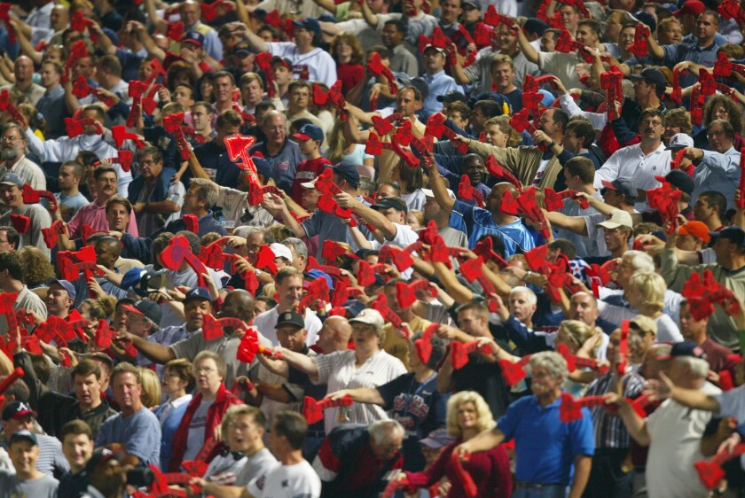 Fans of the Atlanta Braves do the tomahawk chop during a game against the San Francisco Giants.