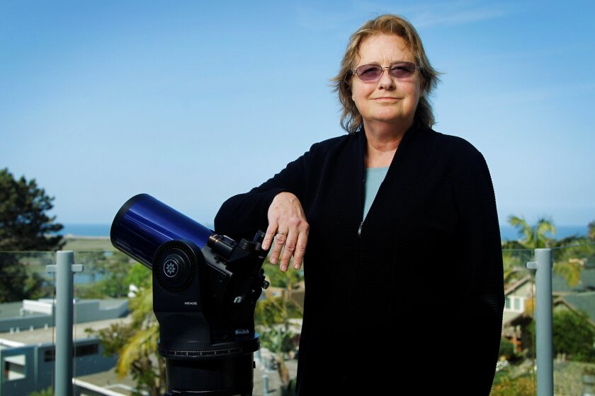 Jeanne Loring, stem cell researcher and astronomy buff, at home with one of her telescopes.
