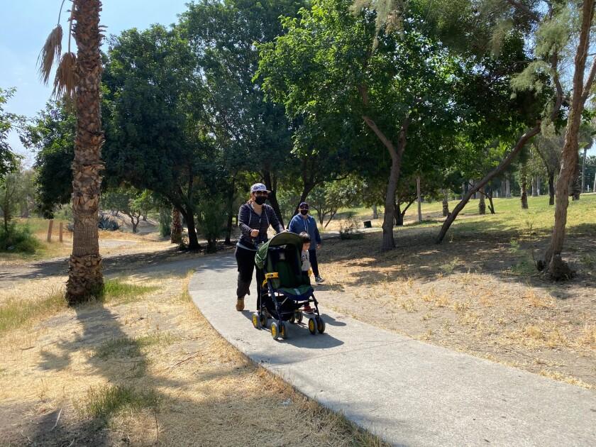 Tijuana resident Marcela Gonzalez, 44, pushes her son's stroller