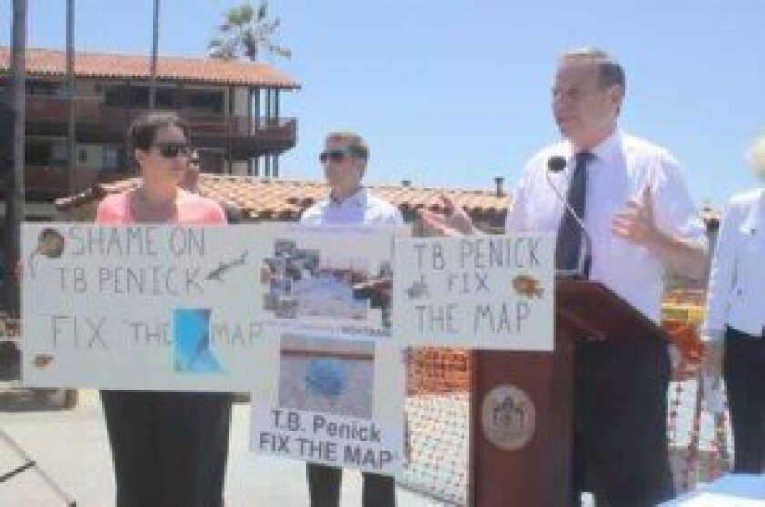 Mayor Bob Filner (right) shows his support at a press conference announcing a lawsuit against T.B. Penick and Sons, the contractors who installed The Map. Ashley Mackin