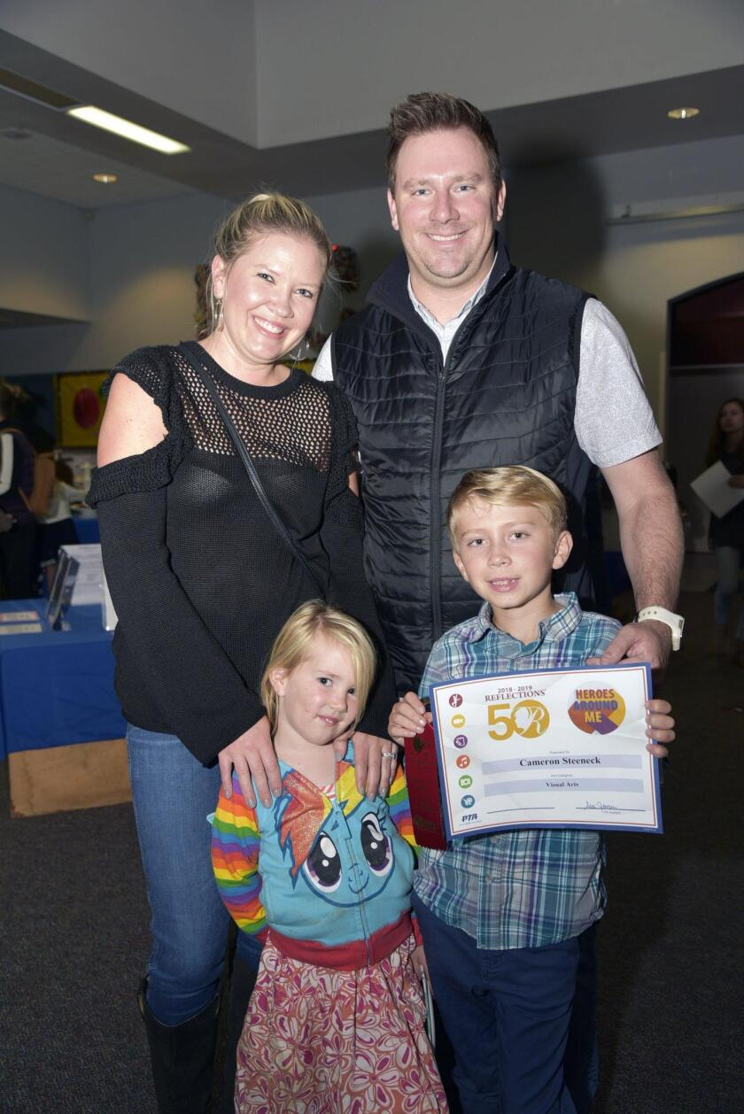 Brooke and Dave Steeneck, with Evie and Flora Vista 1st grade awardee Cameron