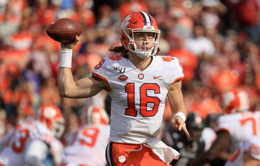Clemson quarterback Trevor Lawrence passes against South Carolina on Saturday.