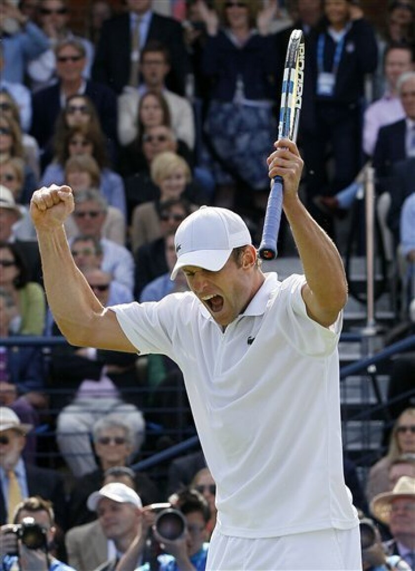 Andy Roddick of USA celebrates winning against Feliciano Lopez of Spain during their singles tennis match at the Queen's Grass Court Championship in London, Tuesday, June 7, 2011. (AP Photo/Kirsty Wigglesworth)