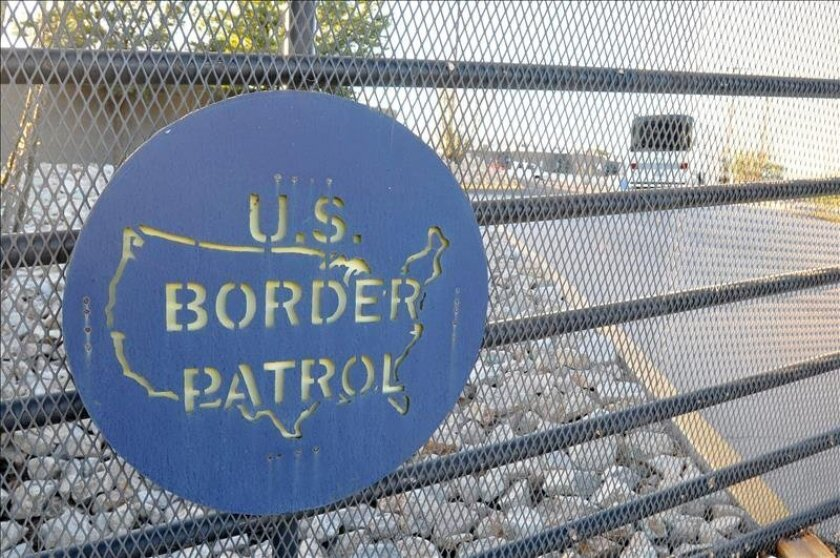 A U.S. Border Patrol sign is seen on a fence southern Texas, near the Mexican border.