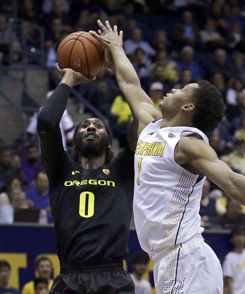 Oregon's Dwayne Benjamin (0) shoots against California's Ivan Rabb, right, in the first half of an NCAA college basketball game Thursday, Feb. 11, 2016, in Berkeley, Calif. (AP Photo/Ben Margot)