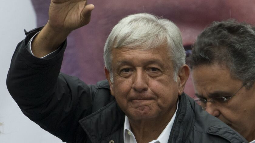 Presidential candidate Andres Manuel Lopez Obrador greets supporters during a campaign rally in Mexico City's Benito Juarez district on May 7, 2018. Mexico will elect a new president July 1.