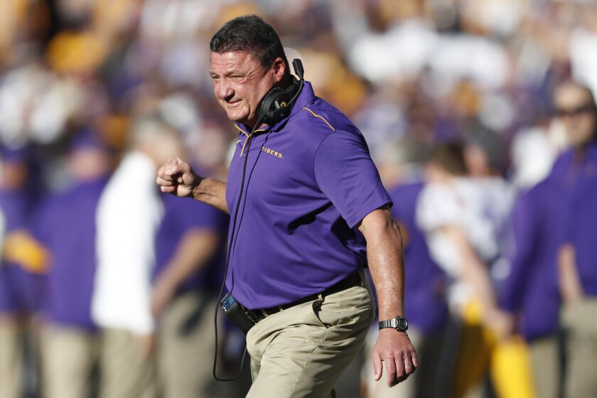 Louisiana State coach Ed Orgeron reacts after a Tigers touchdown in the first half against Alabama on Saturday.