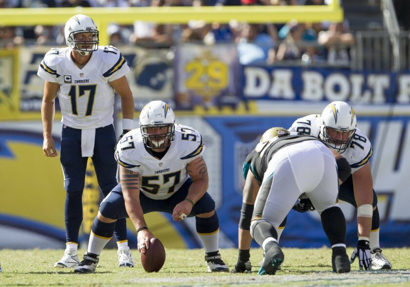 The San Diego Chargers vs. The Jacksonville Jaguars at Qualcomm Stadium.San Diego Chargers quarterback Philip Rivers (17), San Diego Chargers center Doug Legursky (57), and San Diego Chargers guard Chad Rinehart (78).