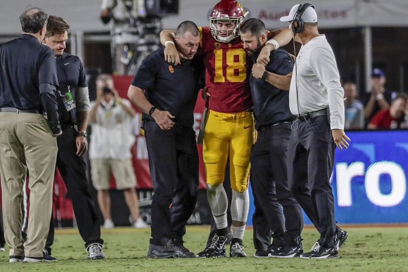 USC quarterback JT Daniels is helped to his feet
