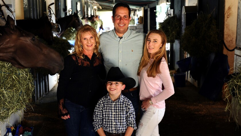 Trainer Phil D'Amato at Santa Anita in 2016 with then-fiancee Sherri Marr, her daughter Jessica, and Ryan.