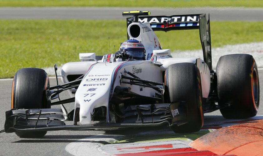 Finland driver Valtteri Bottas of steers his Williams during the third free practice session at the Monza racetrack, in Monza, Italy, Saturday, Sept. 6, 2014. The Formula One race will be held on Sunday. (AP Photo/Antonio Calanni)
