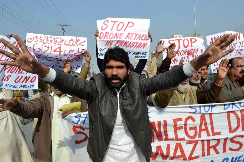 Protesters against U.S. drone strikes shout slogans during a rally in Multan, Pakistan.