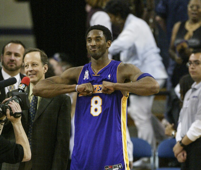 Kobe Bryant interacts with fans before a TV interview with Jim Gray.