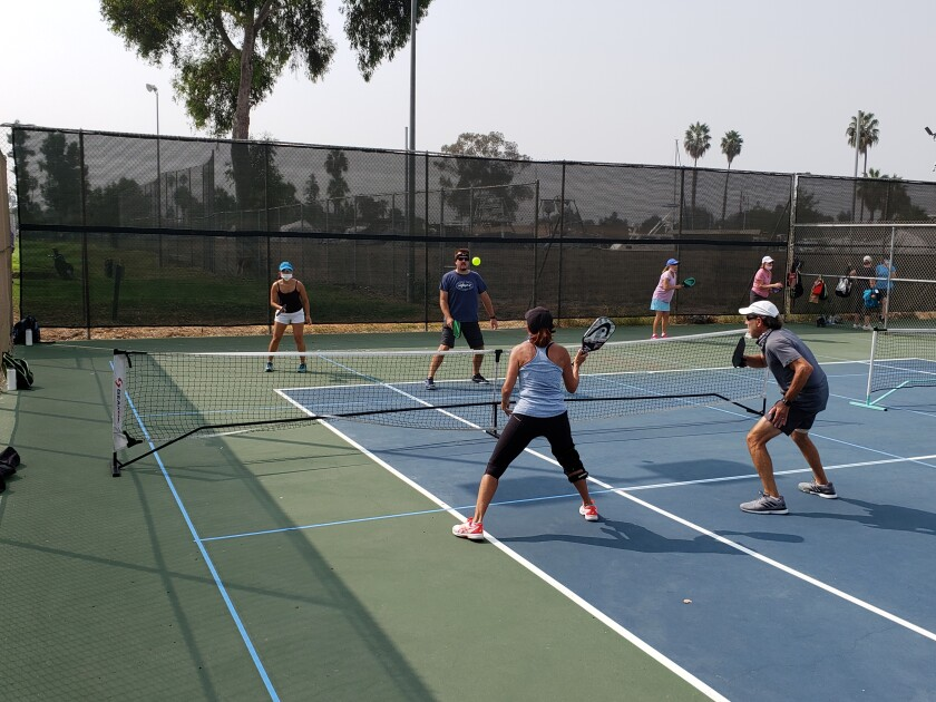 Jodi and David Traver (back) and Kate and Keith Frankel (front) play pickleball at San Diego Pickleball.