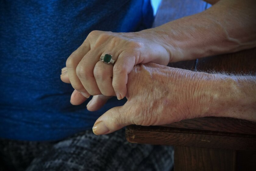 A conference Saturday is aimed at helping those caring for someone with Alzheimer's face the many challenges ahead.
