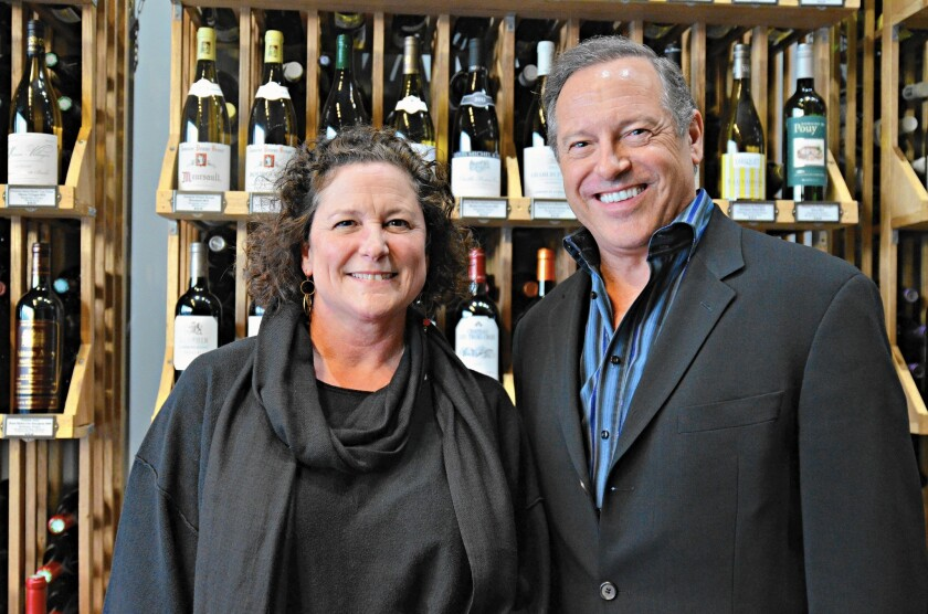 Nancy Milby, left, and Peter Neptune own LCA Wine and Neptune's School of Wine at the South Coast Collection in Costa Mesa.