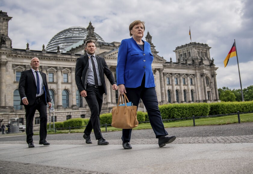 Chancellor Angela Merkel accompanied by her bodyguards in Berlin on Wednesday.