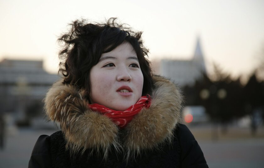 In this Sunday, Feb. 14, 2016 photo, Pak Mi Hyang, a 22-year-old children's camp worker, of North Korea is interviewed as she makes her way towards an underground subway station in Pyongyang, North Korea. North Korea launched a rocket on Feb. 7, carrying what it said was an Earth observation satell