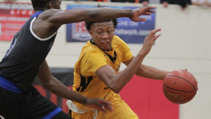 Mission Bay's Rejean Ellis drives against Bishop O'Connell's Xavier Johnson during first half