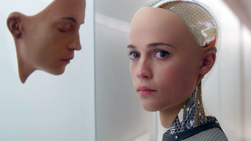 """In this image released by A24 Films, Alicia Vikander appears in a scene from """"Ex Machina."""" Vikander"""