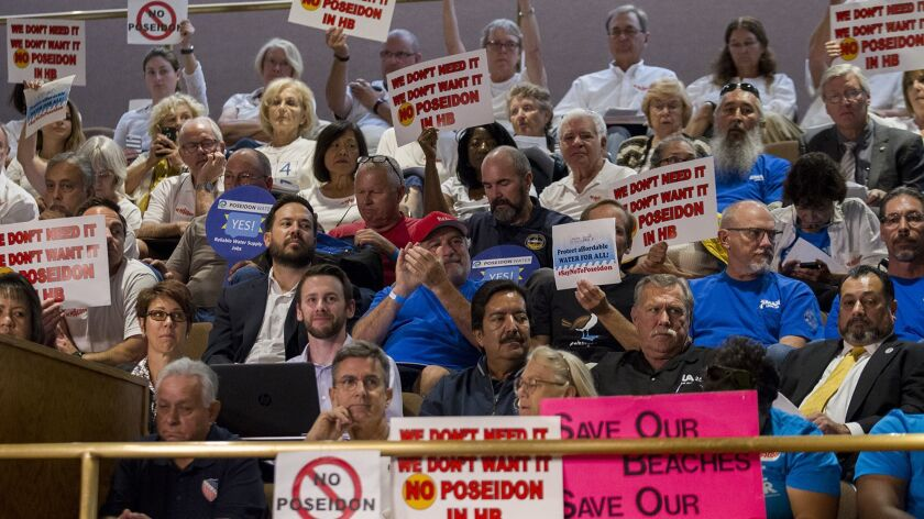 Detractors and supporters of the Poseidon desalination water facility voice their opinion during the