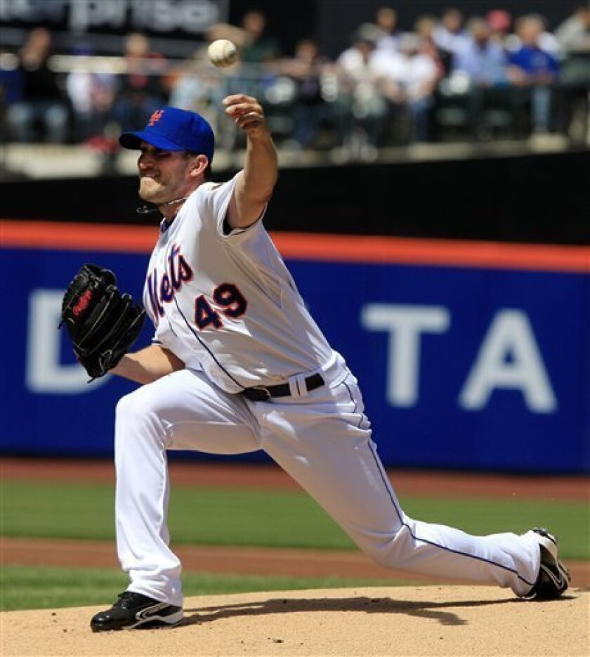 New York Mets' Jonathon Niese delivers a pitch during the first inning of a baseball game against the Atlanta Braves on Sunday, April 8, 2012, in New York. (AP Photo/Frank Franklin II)