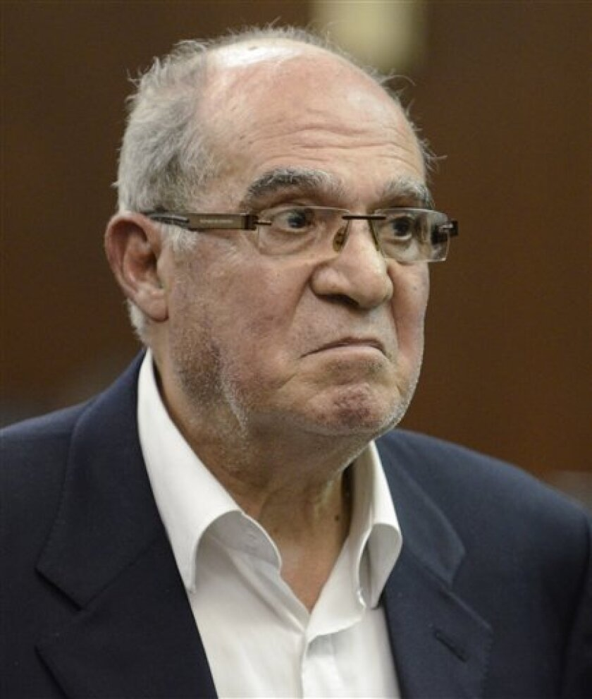 Egyptian businessman Mahmoud Abdel Salam Omar is arraigned at Manhattan criminal court Tuesday, May 31, 2011, in New York. The former chairman of one of Egypt's major banks was arrested on charges of sexually abusing a maid at a Manhattan hotel. (AP Photo/James Keivom, Pool)