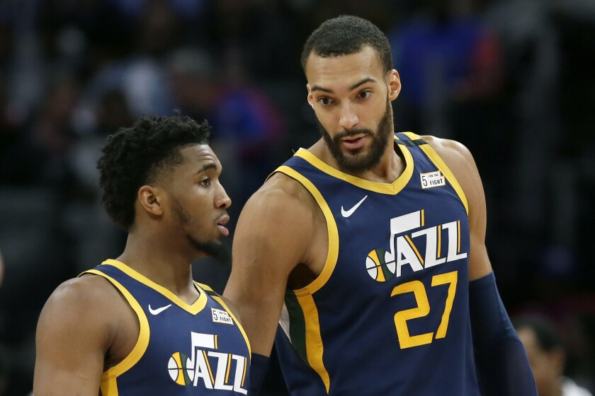 Jazz center Rudy Gobert (27) and guard Donovan Mitchell have both tested positive for COVID-19 as the coronavirus outbreak became a pandemic.