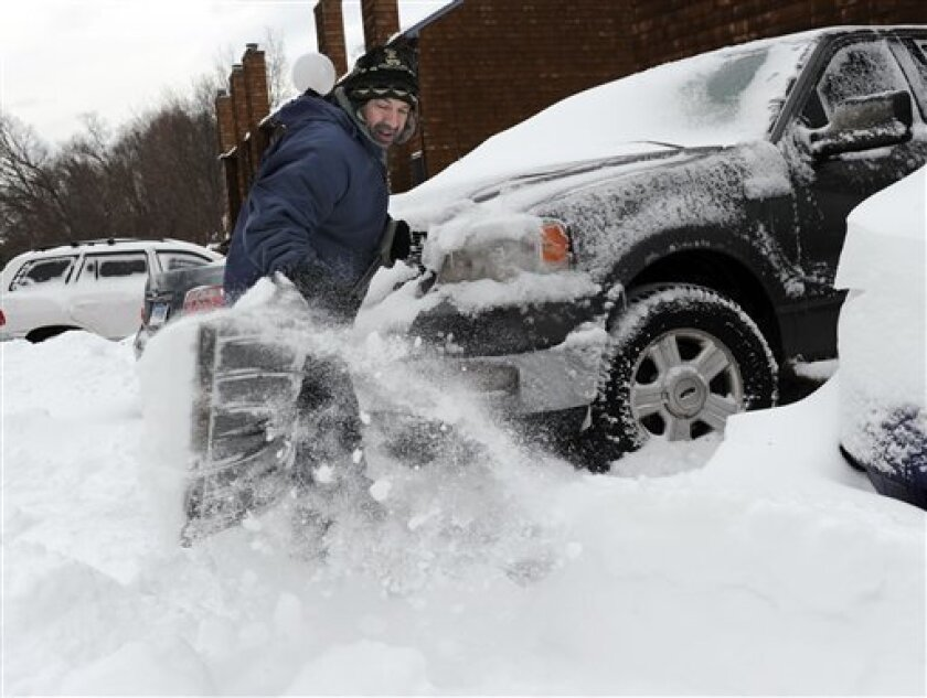 Richard Effinger, 43, digs his truck out from the snow Saturday morning, Feb. 9, 2013 in Danbury, Conn. A behemoth storm packing hurricane-force wind gusts and blizzard conditions swept through the Northeast overnight. (AP Photo/The News-Times, Carol Kaliff) MANDATORY CREDIT: THE NEWS-TIMES, CAROL