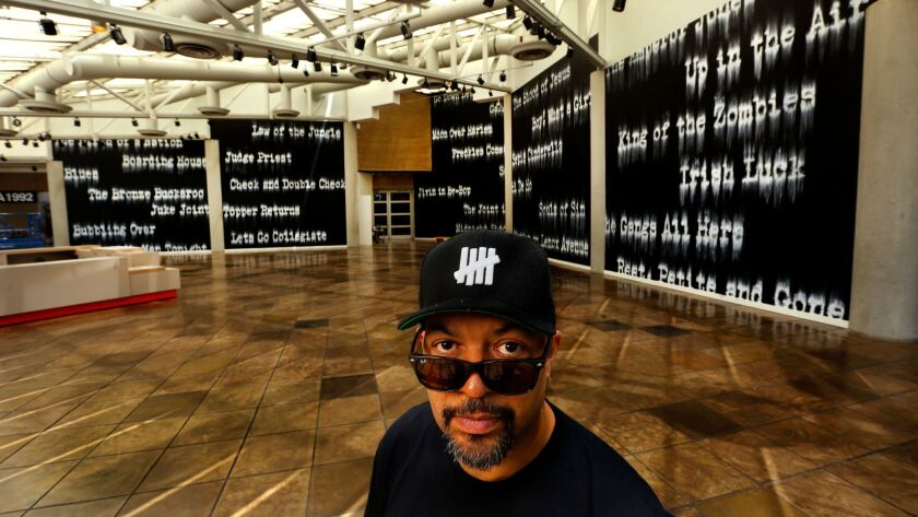 """Artist Gary Simmons in front of his mural installation """"Fade to Black"""" at the California African Ame"""