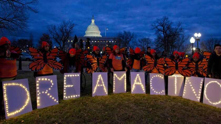 FILE - In this Jan. 21, 2018, file photo, demonstrators rally in support of Deferred Action for Chil