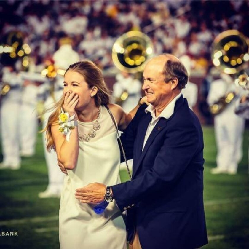 Missy Pittard and her father Dan Pittard, a 1971 Georgia Tech graduate and former Mr. Georgia Tech, hear her name announced. Photo by Elliott Brockelbank