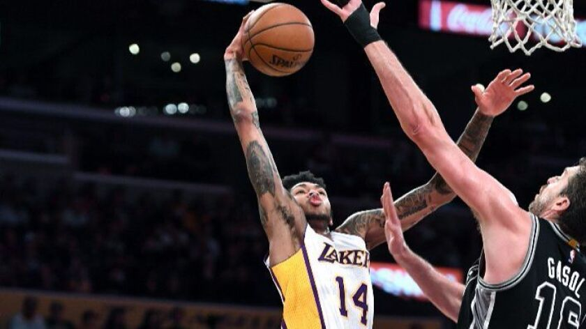 Lakers forward Brandon Ingram goes up for a dunk on Spurs forward Pau Gasol at Staples Center on Sunday.