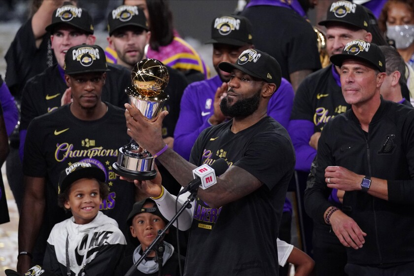 LeBron James, with the NBA Finals MVP trophy, and the Lakers are likely to start defense of their title on Dec. 22.