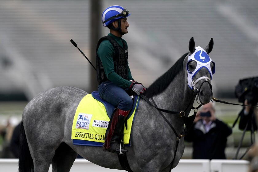 FILE - Kentucky Derby entrant Essential Quality waits to work out at Churchill Downs in Louisville, Ky., in this Thursday, April 29, 2021, file photo. Essential Quality was set as a 2-1 favorite for the Belmont Stakes. Essential Quality went off as the Derby favorite and finished fourth. (AP Photo/Charlie Riedel, File)