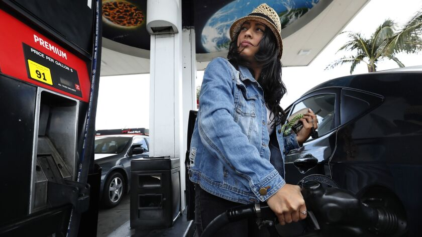VAN NUYS, CA-MAY 25, 2018: Jessica Martinez of Sherman Oaks fills up the tank on her Hyundai Accent