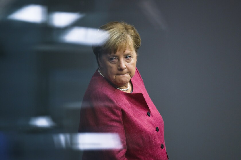 German Chancellor Angela Merkel arrives for a debate about her policy as part of Germany's budget 2021 debate at the parliament Bundestag in Berlin, Germany, Wednesday, Sept. 30, 2020. (AP Photo/Markus Schreiber)