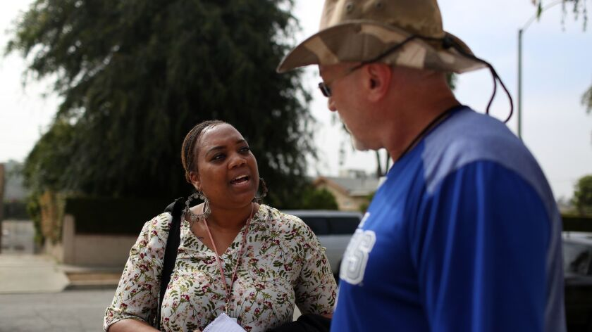 Tina Webb, a clinician from the county Department of Mental Health, speaks with Eric Blomgren.