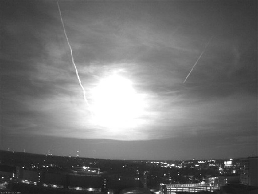 This black and white photo from a rooftop webcam released Thursday, April 15, 2010, by the University of Wisconsin-Madison Department of Atmospheric and Oceanic Sciences shows a fireball as it passed over Madison, Wis., Wednesday night. National Weather Service meteorologist David Sheets in Davenpo
