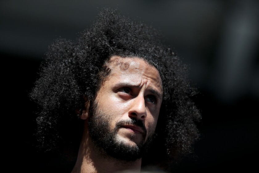 Former San Francisco 49ers Colin Kaepernick watches a match at the U.S. Open on Aug. 29 in Queens.