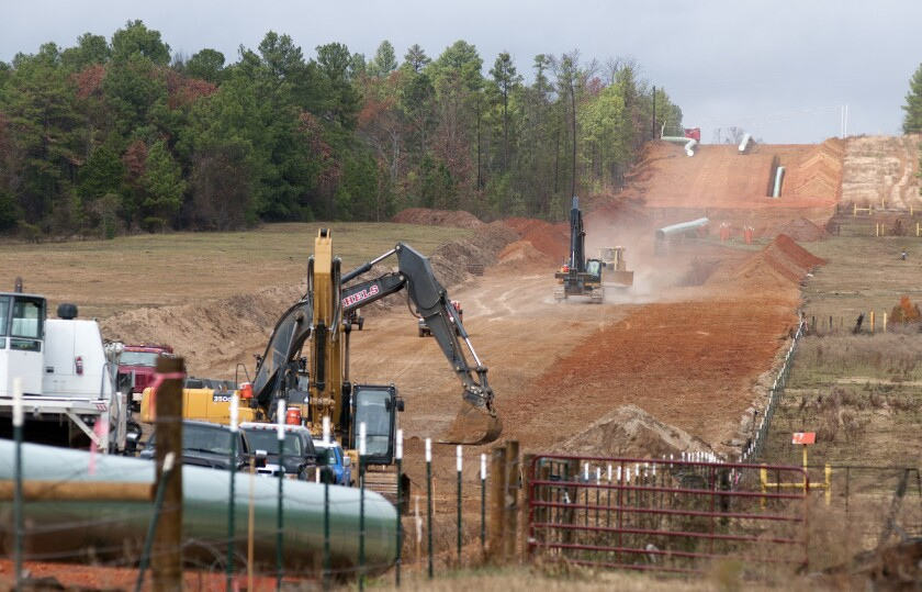 Crews clear a route in preliminary construction work for the proposed Keystone XL pipeline near Winona, Texas.
