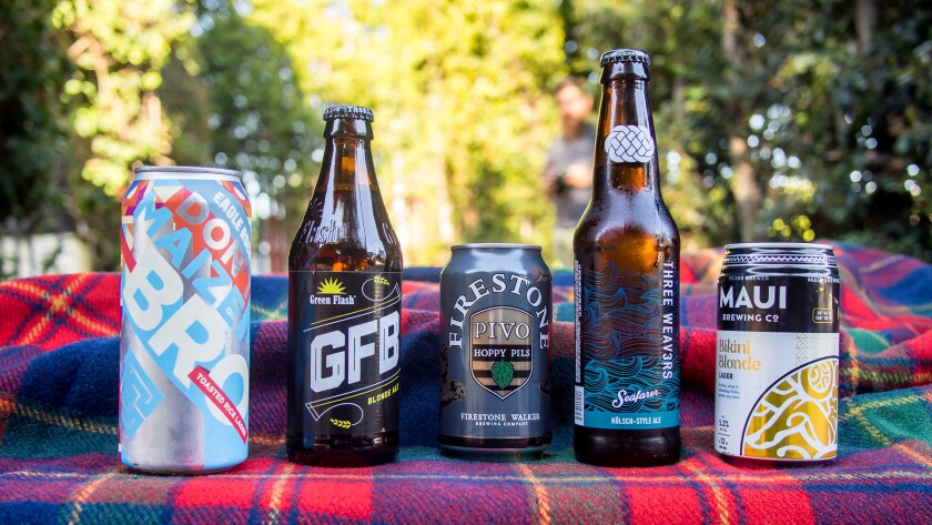 From left, Eagle Rock Brewery's Don't Maize Me Bro lager, Green Flash Brewing Co. Blonde Ale, Pivo Hoppy Pils from Firestone Walker Brewing Co., Seafarer Kolsch from Inglewood's Three Weavers Brewery and Bikini Blonde from Maui Brewing Co.