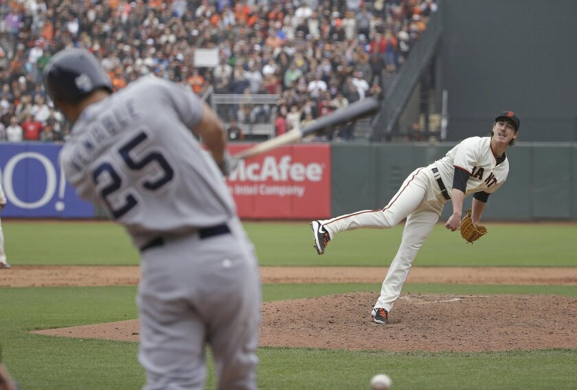 San Francisco Giants starting pitcher Tim Lincecum watches as San Diego Padres' Will Venable grounds to second base for the final out of a baseball game Wednesday, June 25, 2014, in San Francisco. Lincecum threw his second career no-hitter as San Francisco won 4-0. (AP Photo/Eric Risberg)