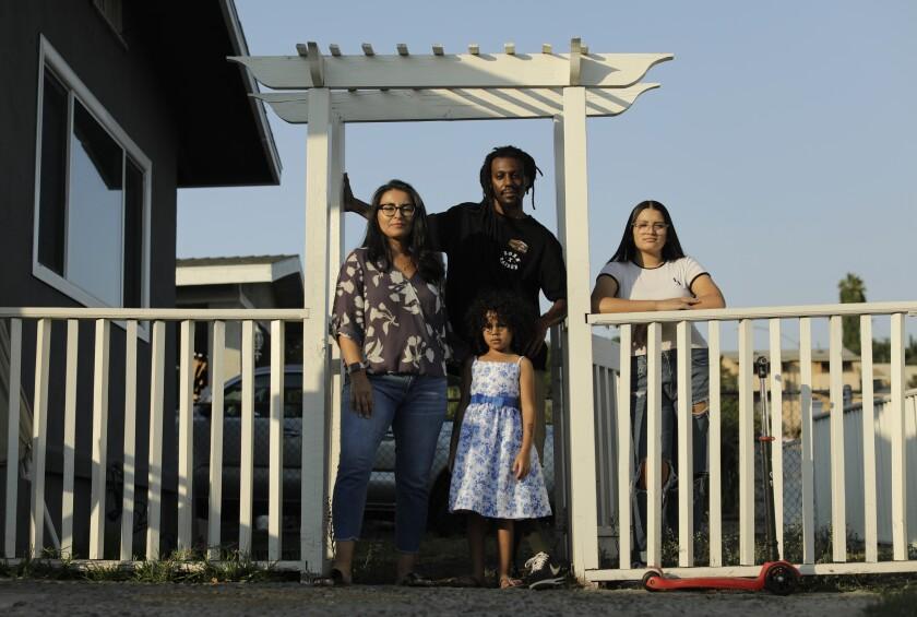 Alma Zaragoza-Petty and Jason Petty with daughters Soul, 5, and Luna, 15
